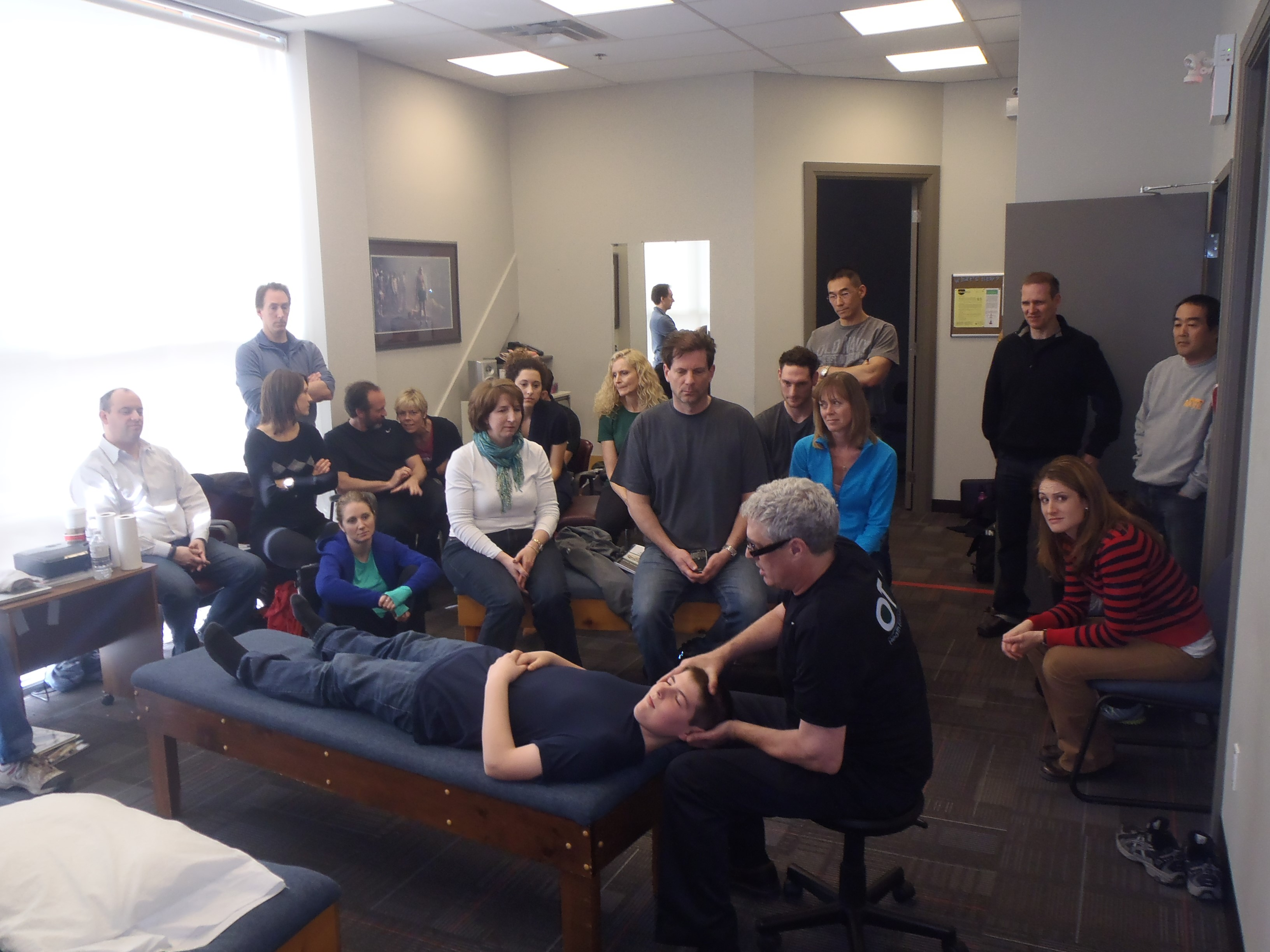 Dr. Murphy performs an adjustment before the crowd at the OTZ Seminar in Toronto.